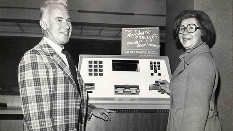Black and white photo of Wells Fargo striking a deal with FICO in 1972 and showcases first ATM machine